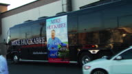 Pan Mike Huckabee tour bus and a group of supporters