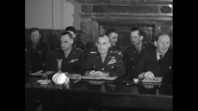 Pan numerous American British Russian military and civilian participants gathered around conference tables at Allied Control Council headquarters at...