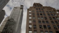 A pan of a group of skyscrapers on Lexington Ave in New York City on a cloudy day.