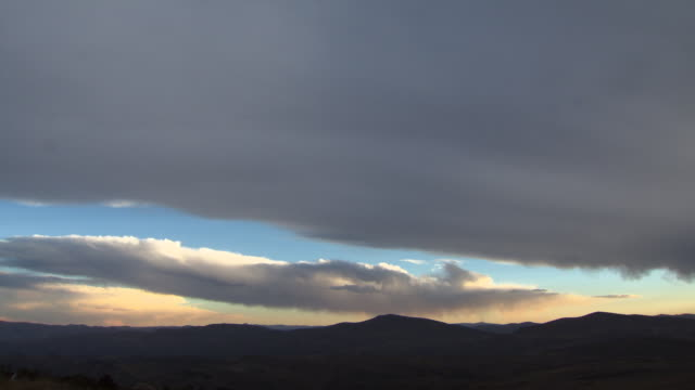 L-R Pan of dramatic mountains with blue and yellow cloudy sky, Oruco mountain range, Bolivia
