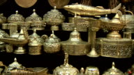 Pan of silverware and other ornaments for sale in souk, Muscat, Oman