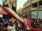 Pan over a proAssad rally in Syria