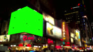 Pan over big Green screen Chroma Key in intersection NYC