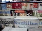Pan over interior-design magazines on shelf / New York City