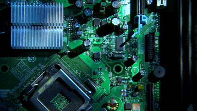 Pan over the components on a circuit board.