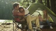 MS Pan R to L and L to R of family camping by lake