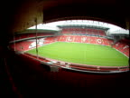 Pan right across Anfield football stadium from stands Liverpool