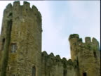 Pan right across Conwy Castle turrets North Wales