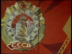 Pan right along Communist workers mural in Russian factory