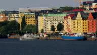 Pan right along Norr Malarstrand from vantage point of Sodermalm across Lake Malaren / Stockholm, Sweden