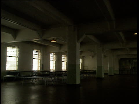 Pan right around dining tables and benches in deserted Alcatraz canteen.
