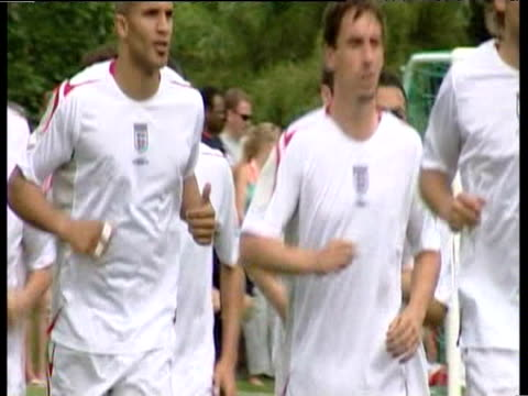 Pan right as England striker Michael Owen jogs with rest of World Cup squad during training session Portugal 17 May 06