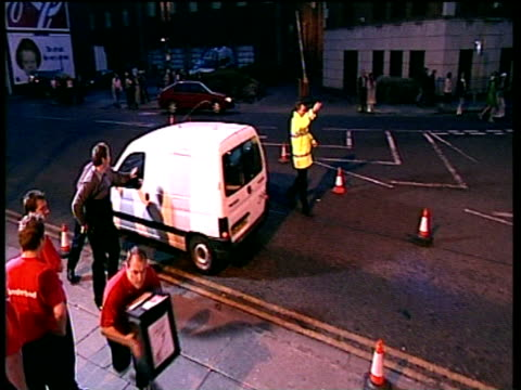 Pan right as man runs down steps with ballot box into counting centre aiming to be first area finished Sunderland 08 Jun 01