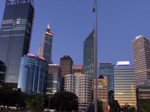Pan right over illuminated skyscrapers in Perth