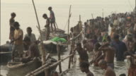 Pan right over people bathing in Gandak River, Sonepur Mela Available in HD.