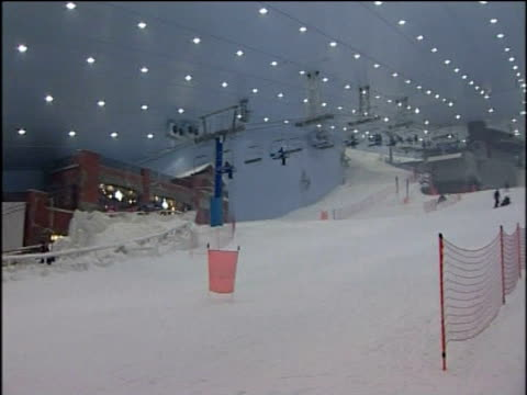 Pan right over slope at world's largest indoor ski resort Ski Dubai