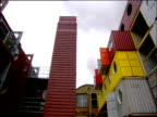 Pan right round office development made of recycled freight containers in London's Docklands
