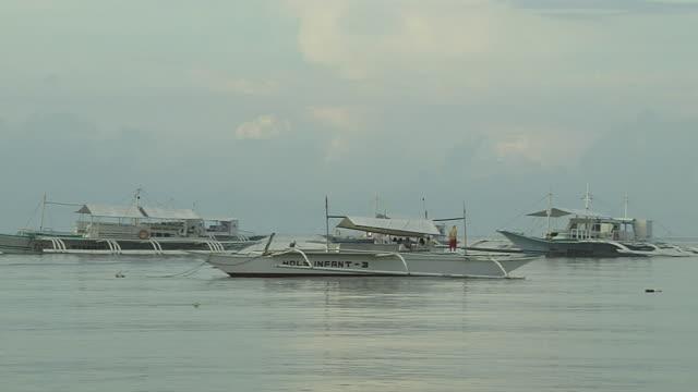Pan Right Shot Boats in the Sea Panglao Island Cebu Bohol Philippines