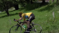 Pan right to left as Bradley Wiggins descends hairpin curve on stage 11 of the 2012 Tour de France