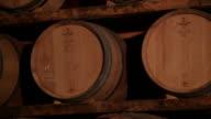 Pan shot of barrels inside wine cellar
