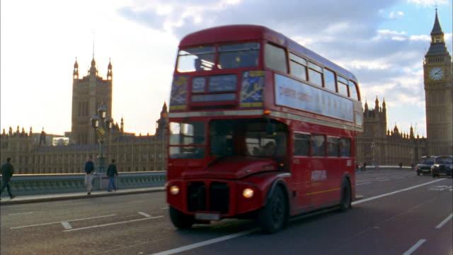 Pan traffic and pedestrians on Westminster Bridge / London