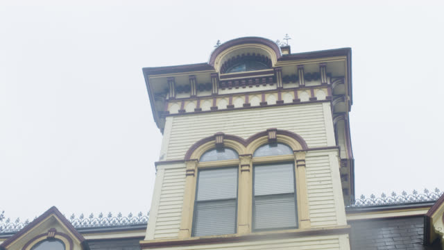 pan up and down multi-story victorian house.