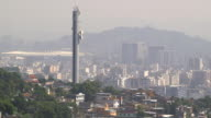 Pan up from a favelas to a tower in the city of Rio de Janeiro.