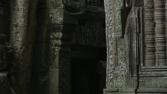 Pan up stone carvings at the Bayon temple in Angkor, Cambodia.