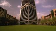 Pan up the Al Faisaliyah Centre skyscraper in Riyadh, Saudi Arabia.