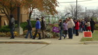 MS Pan ZI Voters waiting in line to cast their ballots at early voting location two days before presidential election / Toledo, Ohio, United States