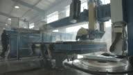 WS PAN_Man operating big stone cutting machine, at factory