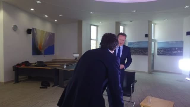 Calls for David Cameron to resign TX Exeter INT David Cameron chatting with reporter as taking seat ahead of interview/