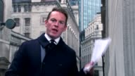 David Cameron faces MPs amid tax affairs row Taxi standing in rain Reporter to camera People along in rain London office building PAN Reporter to...