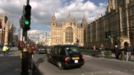David Cameron faces MPs amid tax affairs row T24021646 / TX Traffic along near Houses of Parliament Victoria Tower END LIB