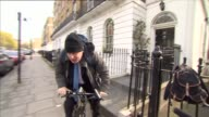 David Cameron faces MPs amid tax affairs row EXT Boris Johnson MP getting on bike and starting to ride away as speaks to press