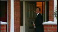 David Cameron publishes six years of tax returns LIB / TX Cameron returning to house turning and smiling before entering home [House that David...