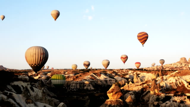 Panaromic view of hot air balloon flying over the fairy chimneys with background Uchisar Castle at Cappadocia