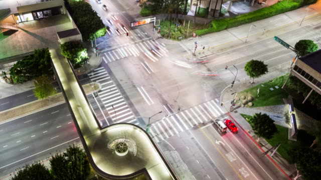 Panning Across a Downtown Los Angeles Intersection from Above at Night