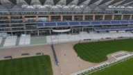 Panning aerial view of the new grandstand and Royal Box at Ascot Racecourse Captured by a licensed UAV operator with PFAW