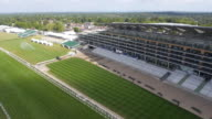 Panning aerial view of the new grandstand at Ascot Racecourse Captured by a licensed UAV operator with PFAW