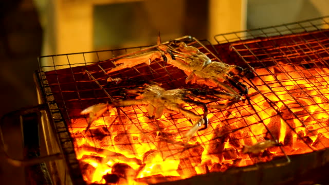 panning :  burnt crab on barbecue at night
