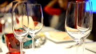 panning: Christmas table setting with many glasses