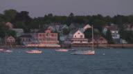 Panning down camera to anchored sailboats