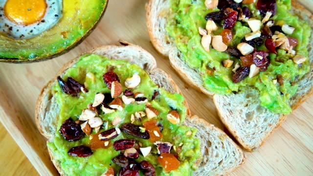 4K panning healthy breakfast, avocado jam sandwish and salad.
