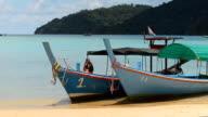 panning : men waiting take  photos of wooden traditional boat
