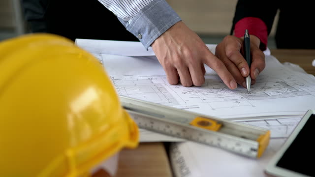 Panning of on engineering equipment and document data on working desk.Illustrate for business or engineering concept.