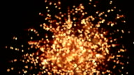 HD panning: out of focus firework at night.