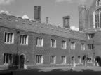 Panning shot across the Base Court buildings to Anne Boleyn's Tower at Hampton Court Palace 1950's