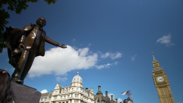 Panning shot across the statue of David Lloyd George on Parliament Square.