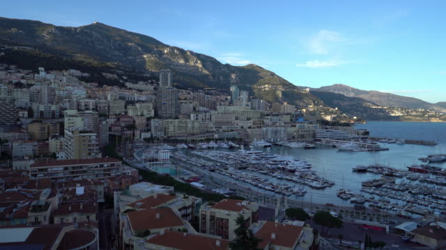 panning shot Aerial Monaco Monte Carlo harbour french riviera sunset